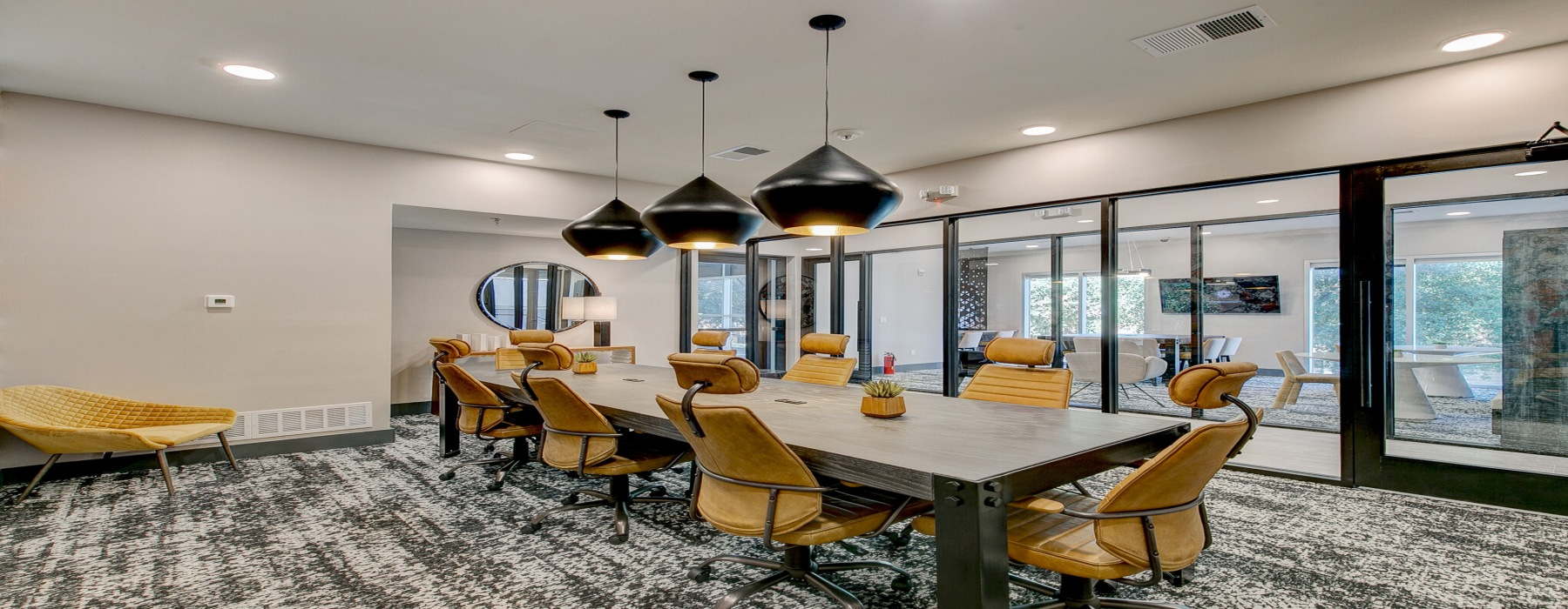 Oak Lawn Apartments in Dallas 24hr boardroom with yellow chairs and a long white table